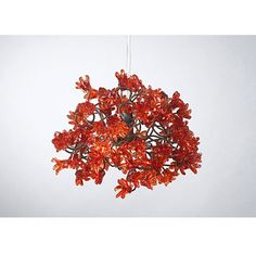 This striking hanging lamp shade is crafted using a bouquet of handmade red polyester flowers. The light emitted from the lamp shines through the red flowers and creates a spectacular warm colored shade on the walls around it. This unique and elegant light piece is an exceptional piece of jewelry for  home. http://www.mavestore.com/product/red-flower-chandelier
