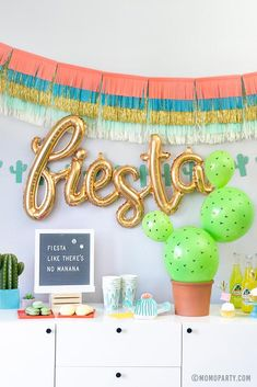 A festive backdrop for a fiesta themed birthday party featuring color fringe garland, cactus banner and foil balloon. Check out the link for more themed party supplies and ideas! Fiesta Party Decorations, Fiesta Theme Party, Kids Party Themes, Balloon Decorations, Party Ideas, Mexico Party Theme, Prom Themes, Boy Birthday Parties, Boys Birthday Party Themes