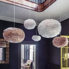 These feather lampshades are amazing!!! If only we had more overhead ceiling lights in our bedrooms to hang these.