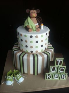"Cake I made for my sister-in-law's baby shower for my first nephew on the way, ""Tucker"".  The monkey, bottle, and shoes are all made from fondant.  The blocks are chocolate with fondant letters and outlines.  TFL! http://www.modernbabyshowers.blogspot.com"