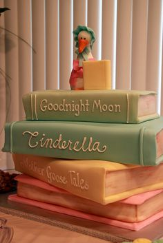 Book cake.... Aw! But with The Velveteen Rabbit, Beatrix Potter, and Winnie the Pooh. :) (so I guess a British version)