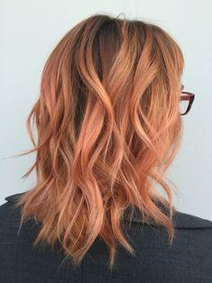 Peach hair. Orange hair. Rose gold hair. Medium hairstyles.