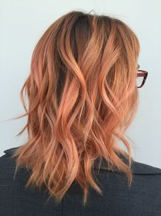 Peach hair. Orange hair. Rose gold hair. Medium hairstyles.