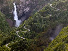 The beautiful winding road of Stalheimskleiva in Norway, with the magnificent Stalheimsfossen waterfall with its 126 meter vertifcal drop in the background. Winding Road, Beautiful Images, Norway, River, Outdoor, Beauty, Landscapes, Drop, Popular
