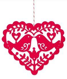Scandinavian paper cut Christmas ornament.