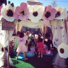 So Pretty! tinkerbell party pixie hollow tent I can try and make the big flowers!
