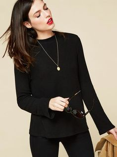 Snuggle up. This is a boxy fit top with a wide mock neck.