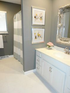 DIY Bathroom Remodel on a Budget: See how this blogger completely transformed her 1970s bathroom on the cheap just by using paint! LOVE this!