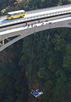 Jaccuzzi.ch, a group of Swiss has suspended a hot tub from the 600 foot high Gueuroz Bridge in western Switzerland.
