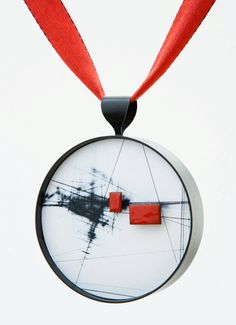 Julia Turner, Medal honoring Elizabeth Shypertt, 2011.  Commissioned by the Bay Area Metal Arts Guild. Steel, wood, stain, vitreous enamel. 2 x 2 x 1/2 in (5 x 5 x 1.3 cm).