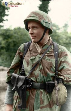 Normandy 1944 A young Panzer grenadier of the 21st Panzer Division. He's wearing a flare gun holster on top of his zeltbahn.