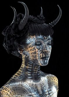 Stunning images: Rosner has been inspired to use his skills as a body painter to create horned demons (pictured) and geometric Geishas