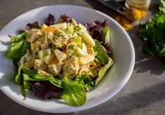 Chicken Curry Salad lightened up with half Greek yogurt/mayo mix tossed with apples, raisins,  celery,  and curry powder!