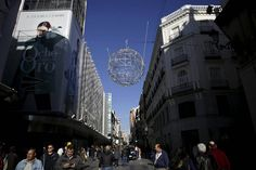Christmas decoration is seen in a central shopping street in Madrid. Spain is on track...