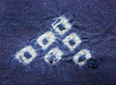Below, two small knots that were overlooked, or could not removed, following the shibori process.Daily Japanese Textile