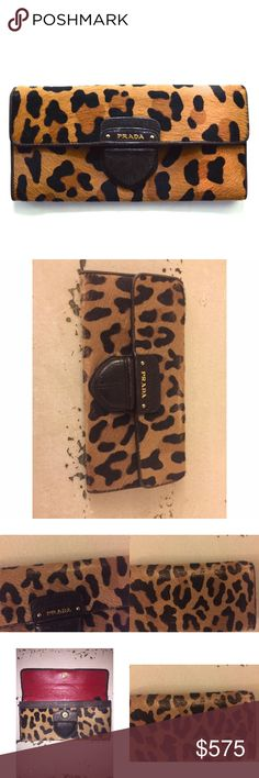"""Prada Leopard Wallet * Brown/tan dyed leopard-print calf hair with dark brown leather trim. * Golden hardware. * Flap top. * Prada logo on snap closure. * 4 1/4""""H x 8 1/4""""W. * Made in Italy. Some of the calf hair is worn off, still in great condition. Prada Bags Wallets"""