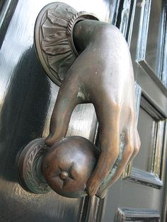 Love this apple door knocker. The hand is realistic and it's like a piece of sculpture work.