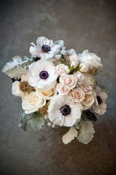Snowy white anemones with beautiful black centers.  When they  keep the company of other flowers - peonies, ranunculus and pale garden roses...