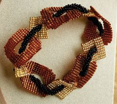 Using strong graphic shapes and a beaded rope, Nancy Zeller's bracelet perfectly illustrates characteristics of art Deco.
