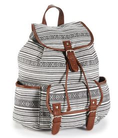 "Stretch out the walk to class for as long as possible -- ya gotta flaunt our cool Stripe Backpack! It's designed with a snap-flap front pocket and two open side pouches; the roomy cinch-top interior even secures with a magnetic snap so your belongings won't fly out. A bold pattern adds a stylish touch.<br><br>W 13"" x H 14"" x D 6.5""<br>Two adjustable back straps.<br>Style: 7330. Imported.<br><br>Cotton canvas with faux leather trim."
