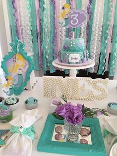 Purple and teal mermaid birthday party! See more party ideas at CatchMyParty.com!