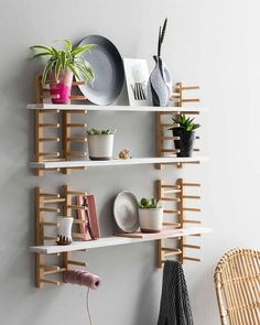 ikea diy hack This hack from VT Wonen starts out with a series of basic OSTBIT wood plate racks, which are mounted on the wall to become customizable shelving. This IKEA hack is somehow both weird and awesome. Ikea Shelf Hack, Ikea Hack Storage, Ikea Hack Bathroom, Ikea Organization, Ikea Hack Kitchen, Ikea Hackers, Diy Ikea Hacks, Ikea Regal, Kitchen Wall Shelves