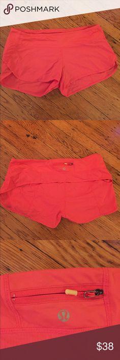 Lululemon shorts size10 Bright coral color shorts. Size 10.  Liner inside.  Excellent condition.  Barley warn lululemon athletica Shorts