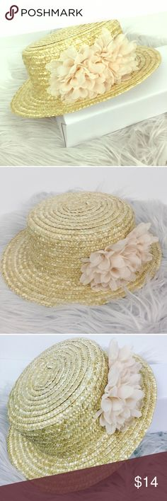 Straw boater hat Re-poshing because the event I wanted it for got canceled 😔.  Lovely hat great for a nice day out at a winery or on a boat.  Looks beautiful and the flowers on the side give it a.fun flirty touch.  Feel free to make an offer! Accessories Hats