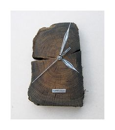 Model no 14 *). This clock is made of construction wood from the buildings of the Old Town of Gdansk. Black oak dating back to the 14th century. Size 12 cm x 27 cm.