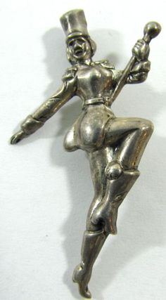 """Lot 302 in the 9.3.13 online & live auction! Lovely sterling silver figural brooch shaped like a drum majorette or band leader. Fabulous detail! Marked """"Sterling"""", measures: 2"""" long. #Jewelry #Fashion #Music #Shopping #POGAuctions"""