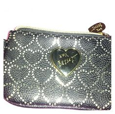Super cute coin purse New only problem I see is the little scratches on the gold heart. Betsey Johnson Bags