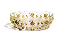 A GEM-SET ROCK CRYSTAL POLYLOBED BOWL, MUGHAL, 18TH CENTURY of eight-lobed form, decorated on the exterior with floral stems on each lobe composed of rubies mounted with inlaid gold wire outlines, the base with a carved flowerhead 9cm. max. diam.
