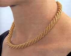 Gold Coral Spiral bead necklace- gorgeous, wonder if i could do this in crochet?