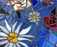 How to Make a Mosaic Stained Glass Table From Scraps  with glue and black grout - Snapguide