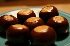 I know. There are already 4 recipes for buckeyes on TK. This one is different, I promise. It is more Reese's Peanut Butter Cup because of the addition of honey and a pinch o' salt. Everyone wants the recipe and there are NEVER any left.
