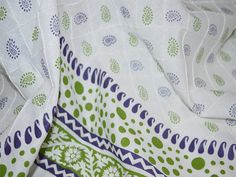 This is beautiful soft cotton pintuck fabric it has printed paisley in green and purple on white background, with border along one selvage for summer dresses, skirts and night dresses.  You can...
