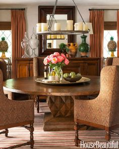 Dalton designed the base of the dining room table to echo the pattern of the leaded-glass windows.