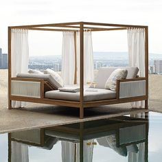 Clean, architectural teak lines frame the Brizo Daybed-whose inner spaces are defined by cloud-like curtains and airy, rope-like strands of wicker. The enclosed facing chaises each recline in four tête-à-tête positions. A poem in solidity, space … and connection. White all-weather wicker, tailored cushions with high-resiliency foam core. Privacy panels are sewn from Sunbrella® high-performing solution-dyed fabric.  Daybed chaises recline to four positions on opposite ends, allowing for easy…