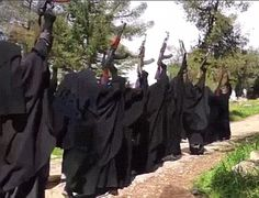 Brutal: Raqqa is patrolled by Islamic State's fearsome all-female Al-Khanssaa Brigade (pictured) who violently impose the group's twisted interpretation of Sharia Law Community Picture, Evil World, Sharia Law, Social Media Channels, Muslim Women, Pretty Girls, Carry On, Squad, Manga