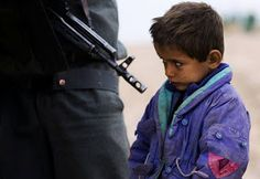Afghanistan's Children of War - In Focus - The Atlantic An Afghan boy watches as his father is searched by a policeman at a checkpoint at Delaram district in Nimroz province, on January (Reuters/Marko Djurica) People Of The World, In This World, Citizen Dive Watch, World Time Zones, Atomic Watch, Boys Watches, Human Dignity, Citizen Eco, Precious Children