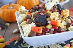monsterMunchHalloweenSnackMix: 4 cups air popped popcorn  3 cups cocoa puffs cereal  1 cup Autumn Colored plain M's or Reese's Pieces  1 cup salted peanuts  1 cup candy corn  10 Halloween Oreos, chopped into bite sized pieces  1 cup pretzels