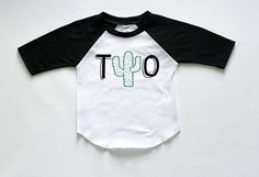 Two! Such a fun age! And what a fun cactus birthday shirt to go along with a fiesta or cactus themed party! Our tees are Kavio brand and are light weight, very soft, and high quality blanks. You can be proud to put this tee on your child and can rest assured that the design wont wash off