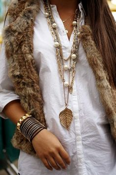 necklace, white shirt, fur vest!