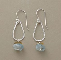 Aquamarines capped with 10kt goldplate disks frolic on hand hammered silverplate teardrops that can be shifted along the wires to drip down or stream upward.