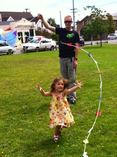 Playing kite with her dads