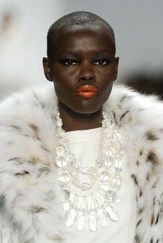 Dennis Basso, red lip on a white coat.