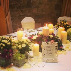 Candles and flowers...it's that simple! #Centrepeices #TableIdeas