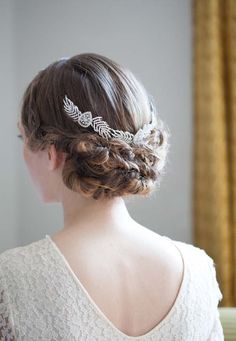 Embrace the Grecian goddess look by pairing a  fishtail braided updo  with an ornate hairpiece. We love the versatility of this particular piece, which can also be worn as a headband or tiara.   Click for hairstyle tutorial.