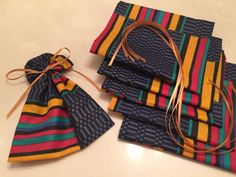 Discover recipes, home ideas, style inspiration and other ideas to try. Mini Gift Bags, Small Gift Bags, Small Gifts, Kwanzaa, African Theme, African Accessories, Wedding Favor Bags, Fabric Bags, African Fabric