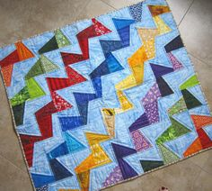 (7) Name: 'Quilting : Tilted Modern Quilt Pattern - a lottle too much primary going on but the diagonal lines, the sort of offness of the pieces...i dunno it just catches my eye